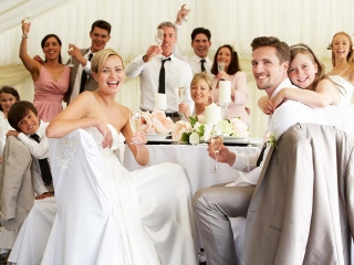 Wedding guest smiling for camera