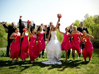 Wedding party jumping for photo